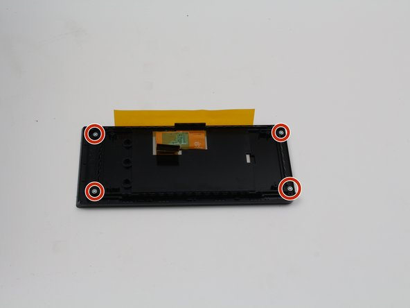 Remove the four 4.8 mm screws from the back of the display using a  T6 screwdriver.