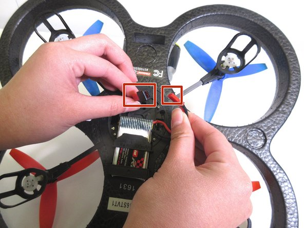 Flip the quadrocopter over so that the underside of the device is facing up.