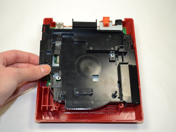 Lift the plastic tray out of the console and set it aside.