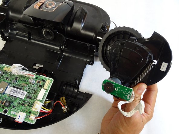 Remove the driving wheel assembly from the POWERbot by grabbing the wheel and lifting upwards.