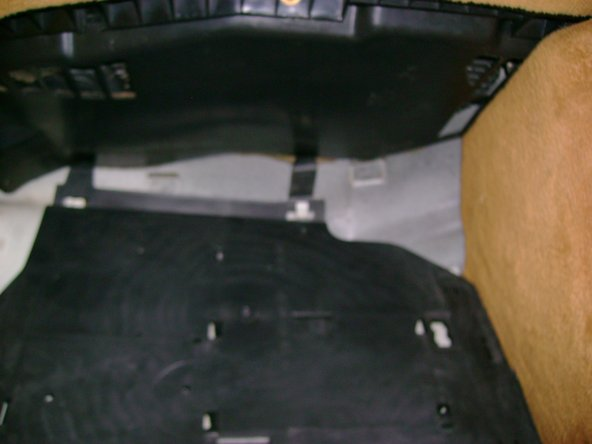 Remove passenger side (right) plastic kick plate.  You must move it up to disengage the metal hooks in the car body from the plastic kick plate clip points (one lower, two upper).  Tilt the panel counter-clockwise and remove toward rear of vehicle. Takes a bit of patience to manuever it effectively to tilt  backward and free from footwell area.