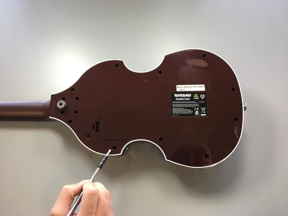 Image 1/2: Pull off the back whole panel so that the bass is now open.