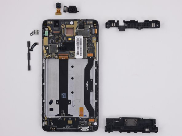 First layer of removable components includes: loudspeaker assembly, antenna, buttons, vibrator bracket, front- and rear-facing cameras.