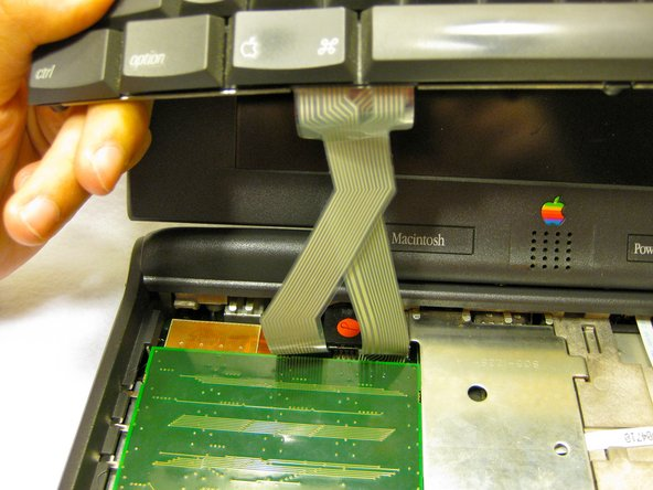 Image 1/3: Pull the keyboard out and repair or replace as needed.