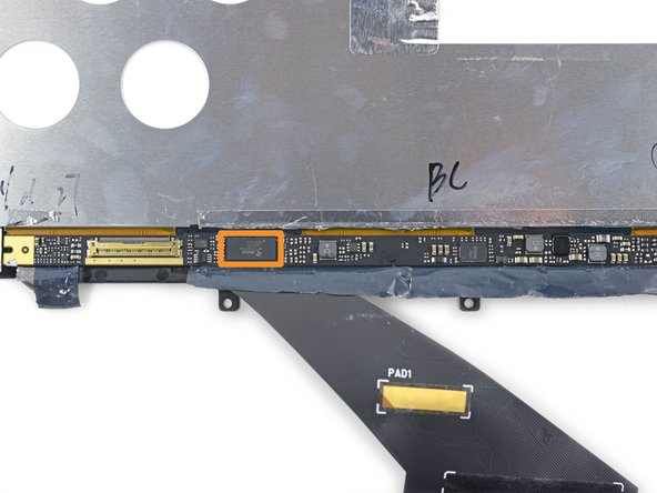 The display driver board lives under some foil tape at the bottom of the panel.