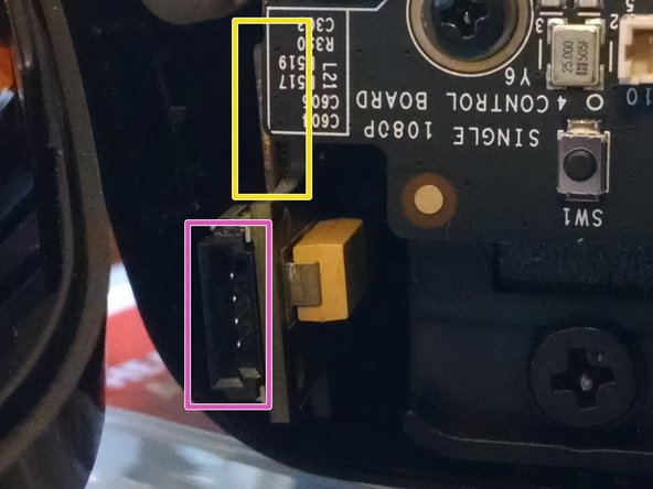 Image 2/2: Flat on the surface of the IR board, about where the yellow arrow points, the orange ribbon cables (which carry the IR LEDs and additional positional tracking circuitry) connect to the IR board with the same sort of flat connector that is used between the faceplate ribbon cable and the main body.