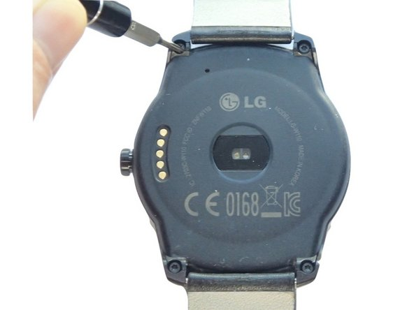 Place the watch upside down on a hard surface so that its back case is facing upright.