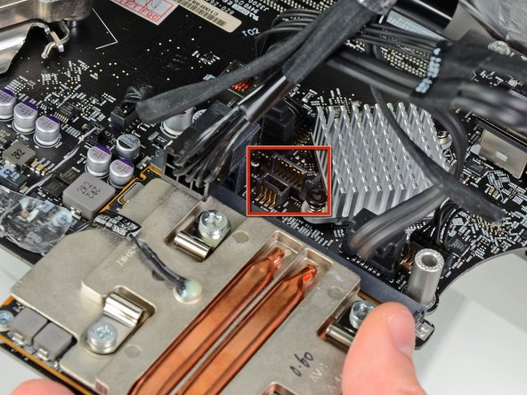In the following steps, you will hold the logic board slightly away from the outer case as you connect the new hard drive cables included with the dual hard drive kit.