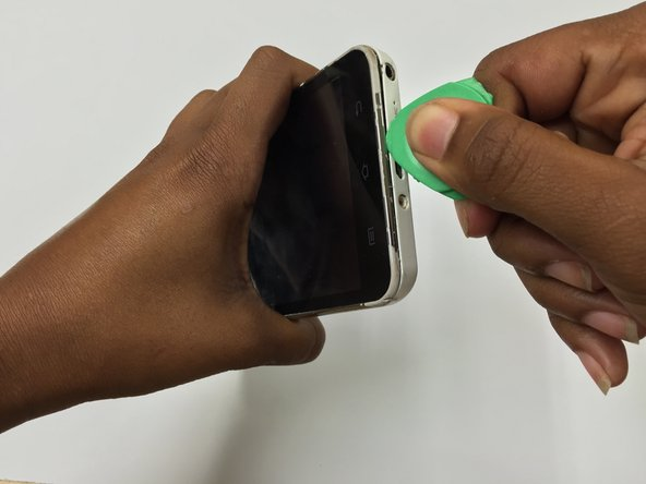 Using the opening pick, pry at the bottom and work around each edge of the device until the front cover and back cover housing is separated.