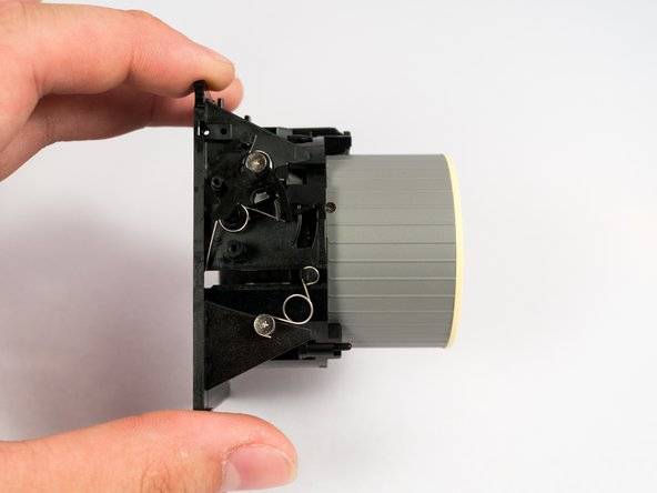 Remove the lens unit from the main camera frame.