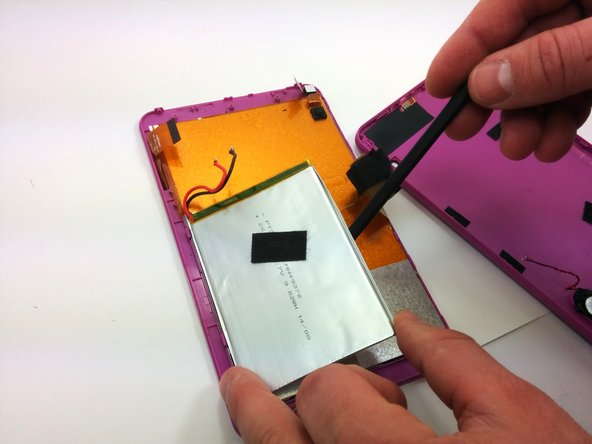 Using a plastic opening tool, pry the battery off of the rest of the body