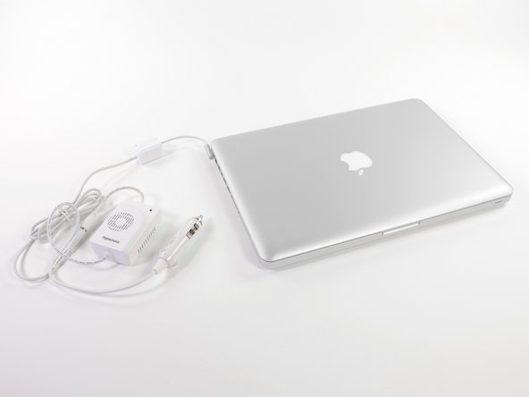 Image 2/3: Connect the modified MagSafe Cable to the MacBook Car Charger to power and recharge your MacBook in the car.
