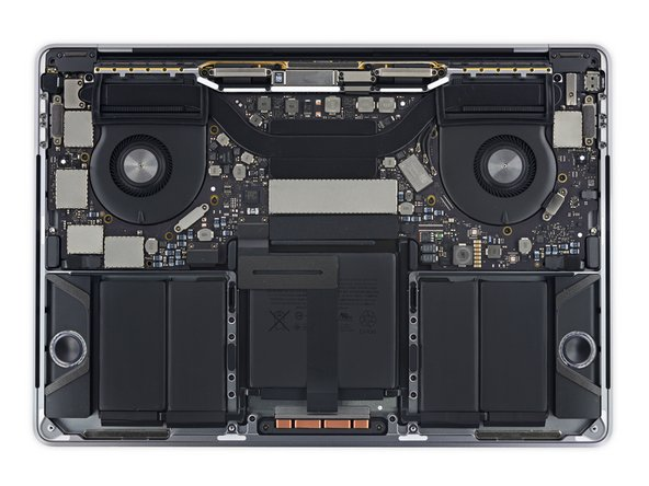 Image 2/3: Touch Bar features: a smaller battery, two fans, double-ended heat sink, no SSD card, and lower speakers (that don't actually line up with their grilles).