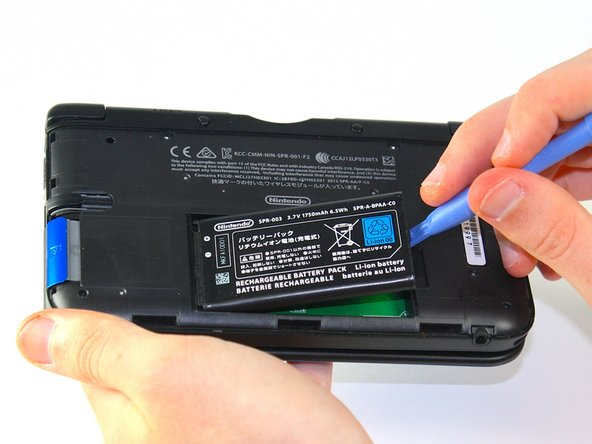 Image 2/3: Lift the battery out of the case and set aside.