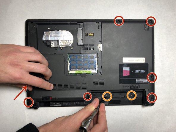Remove the seven black 8mm Phillips #0 screws around the perimeter.