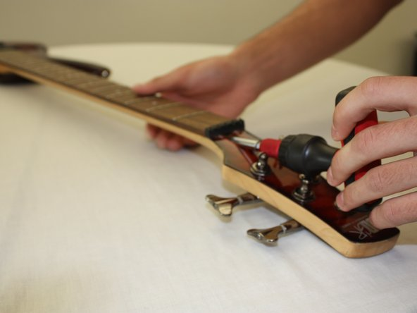 If your fret board is bowing upward towards the strings, loosen the truss rod by turn by turning the hex wrench a quarter to half turn counter-clockwise.