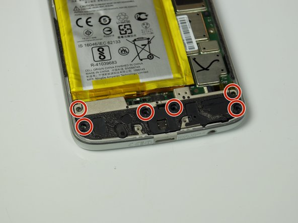 Remove six 3.0 mm T3 Torx screws securing the black battery cable cover at the bottom of the phone.