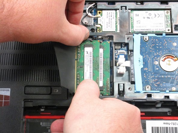 Press the clips on the edges of the RAM modules outward to pop them out.