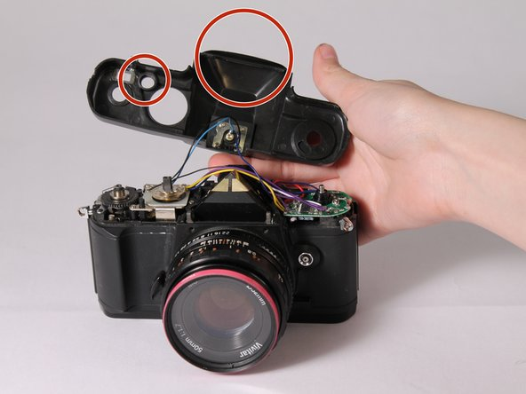 The shutter release button and the viewfinder eyepiece are loose so they may fall out during removal.
