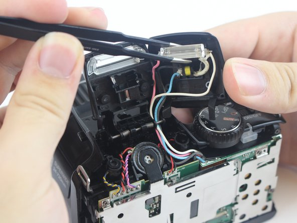 Using a pair of ESD-safe tweezers, remove the flashbulb.