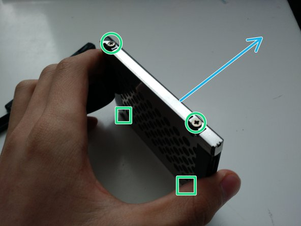 Image 1/1: ...and push the HDD outside from its retention bracket.
