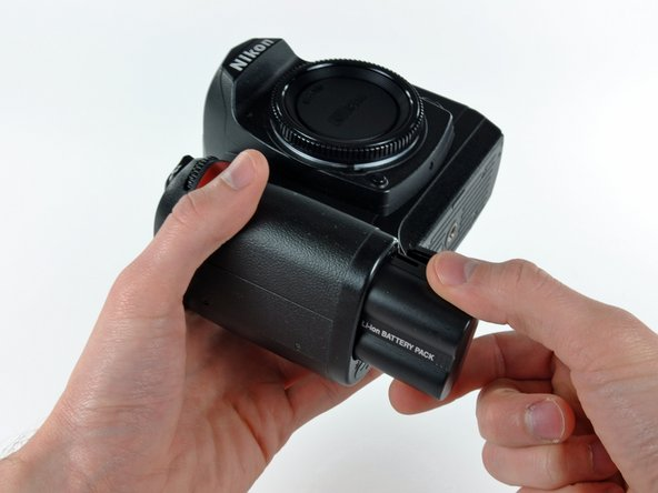 Image 1/1: Pull the battery out of the D70.