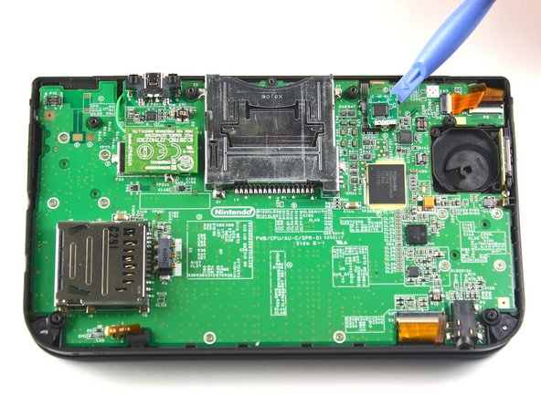 Locate the IR board located on the upper right side of the motherboard.