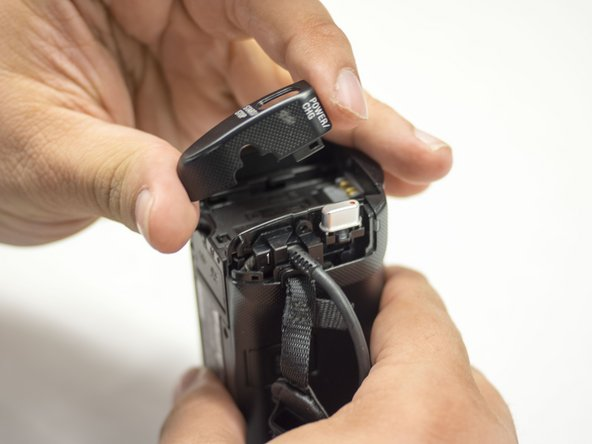 Remove the casing using your right thumb and index finger.