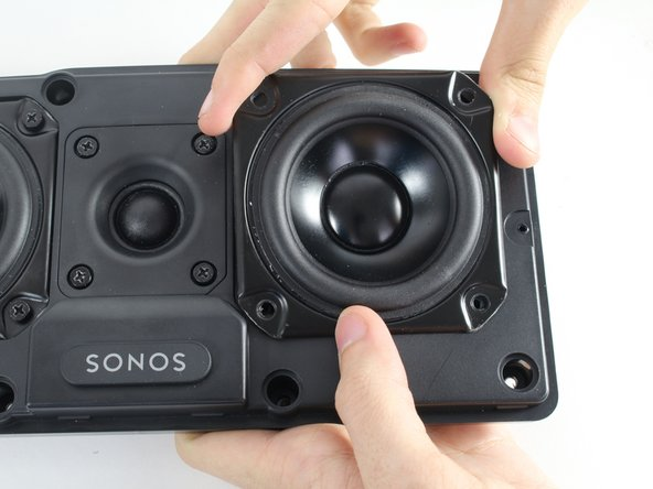 Carefully lift the speaker you need to replace out the front of the panel.