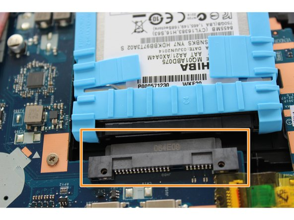 Image 2/2: The hard disk drive should now be free from the black connector port.