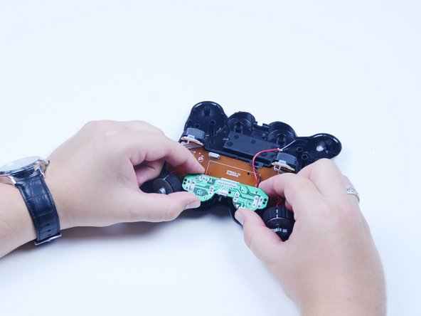 Lift the analog stick board away from the front of the controller.
