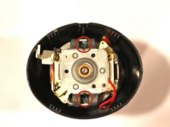 Using a Phillips screwdriver, remove the two screws  holding the motor in place.
