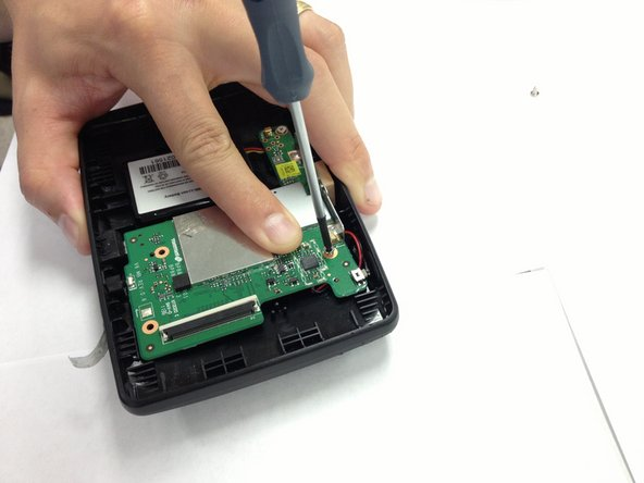 Transfer the green motherboard back into the back plate and secure it with the 3 screws.