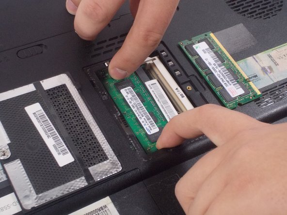 Image 2/3: The second RAM stick should now be sitting at about a 30 degree angle.