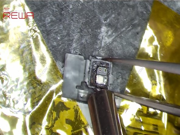 Turn the flex cable upside-down and secure it again. Remove the Flood illuminator module.