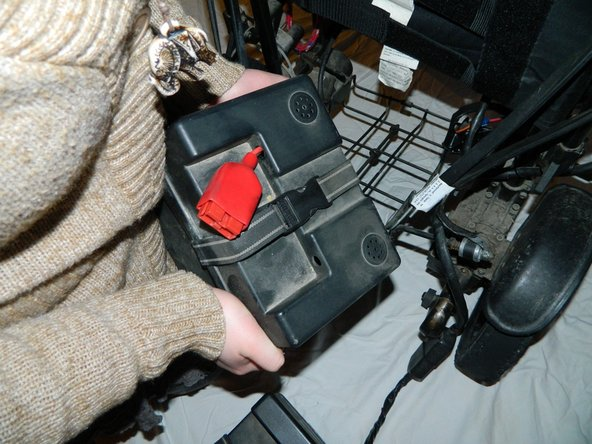Remove the first and second battery from the wheelchair.