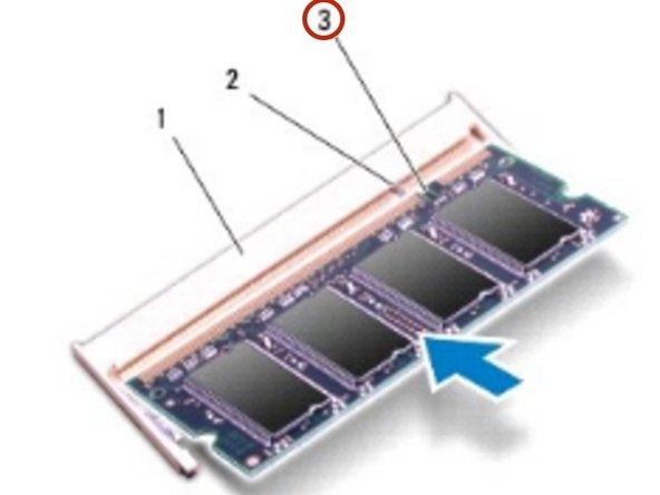 Alinee la muesca en el NUEVO módulo de memoria con la pestaña en el conector del módulo de memoria.