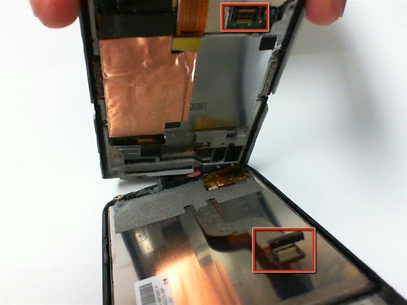 Continue separating the circuit board from the front cover and screen and watch for a ribbon cable to detach.