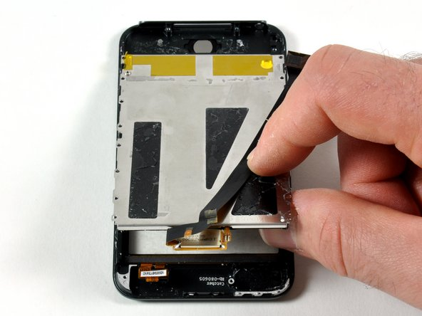 Image 1/2: Separate the display from the front panel by gently lifting it.