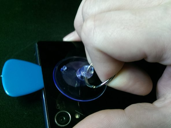 Use a suction-cup to pull up the back-cover about 1mm. Insert a pick and use a second one to make the opening larger.