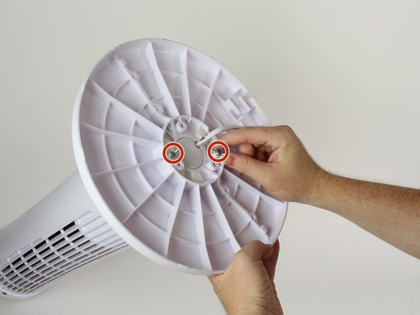 "Remove the two 3/4"" wing screws on the bottom of the fan by rotating them counter-clockwise."