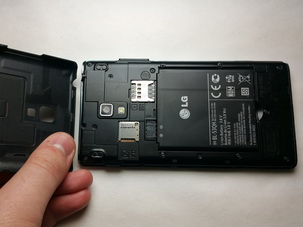 Power off the device and gently lift the battery cover off to access the battery