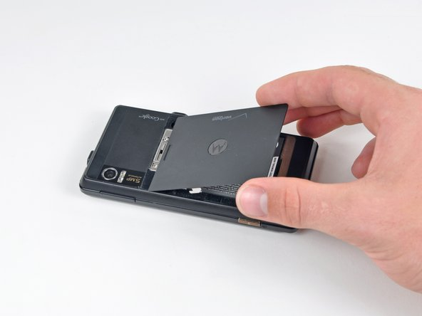 Image 3/3: Lift and remove the battery cover out from the phone.