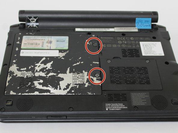 Turn laptop over so the back panel is visible, as shown in the second image.