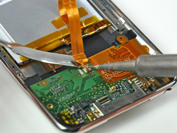 Image 3/3: Beware of overheating the board and the cable. Only hold the tip of the iron against the pad long enough to let the solder melt. Excess heat buildup has the potential to ruin the logic board or melt the ribbon cable.