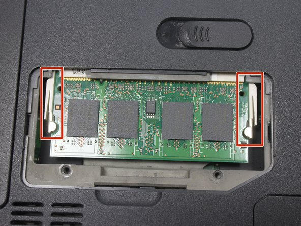 To access the RAM, push out the latches outward on the left and right of the RAM.