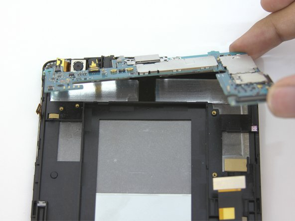 Carefully remove the fragile motherboard from the device.