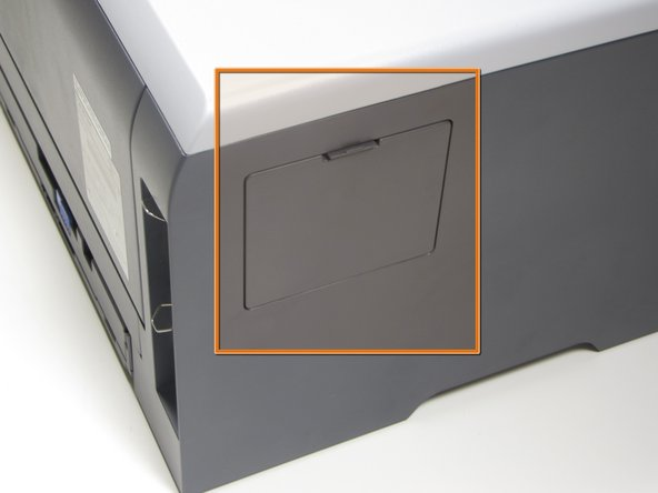 Locate the small removable panel on the left side of the printer.