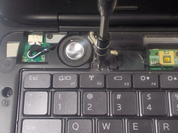 Use a JIS 1 screwdriver to remove (2) 2.5mm screws located near the top of the keyboard.