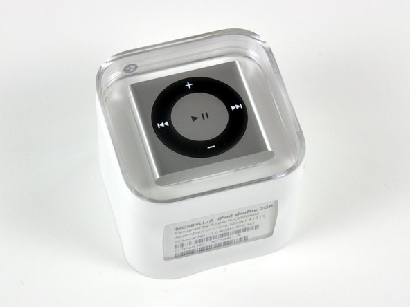 "Image 1/2: Although the Shuffle features ""new, smaller packaging,"" it doesn't feature a similarly resized shipping box. Apple could have shipped 30 iPod Shuffles in this box. Literally."